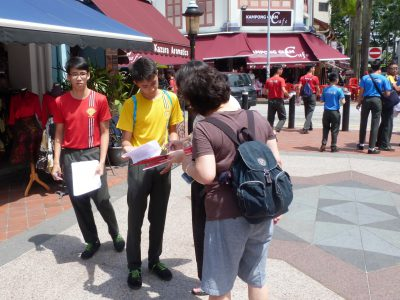 Students interviewing tourists at Kampong Glam